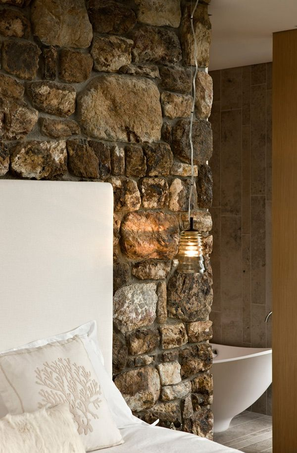 interior stone wall adds rustic touch - Rock Wall Design