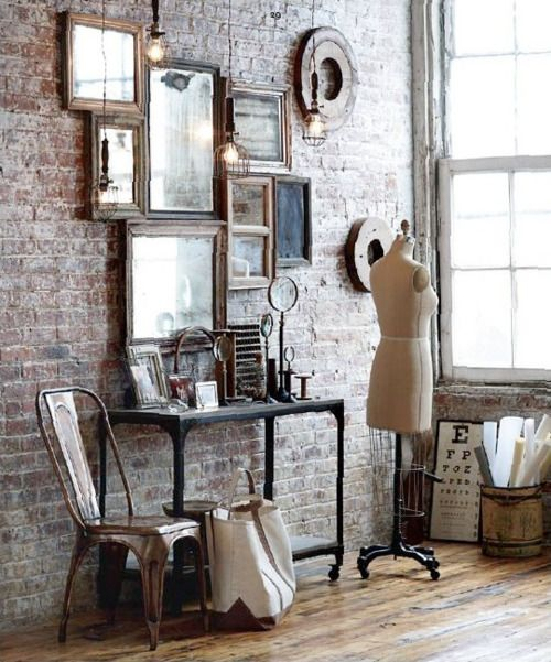 I love the mirrors, the eye chart, the bricks and all the vintage wood and industrial pieces. ahhhhh