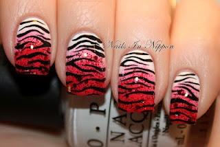 http://nailsinnippon.blogspot.com/2012/02/v-day-pinkred-sponged-tiger-print.html