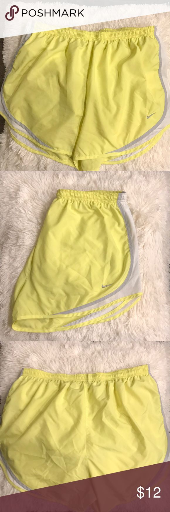 Nike Dri-Fit Running shorts XL Nike dri-fit yellow shorts. Super comfy running shorts. Worn less than five times. No visible stains, rips, or snags. Nike Shorts