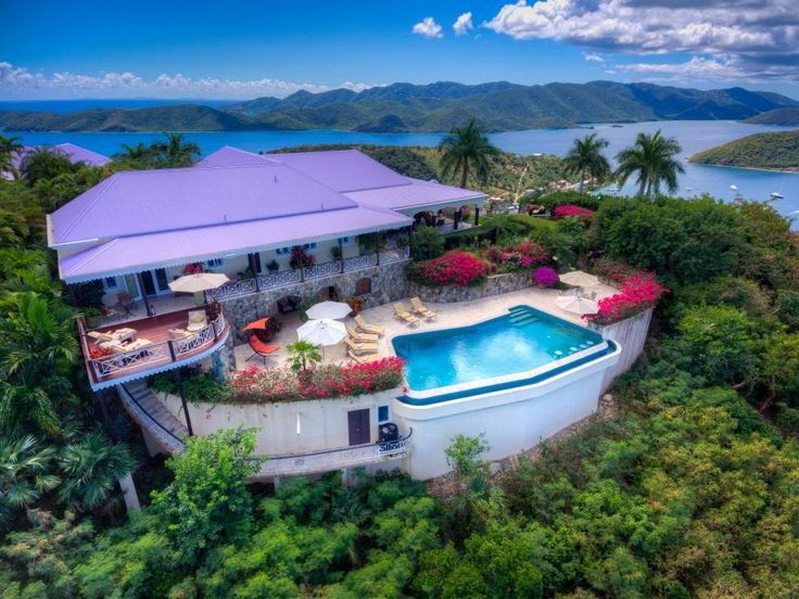 Nestled on eight hilltop acres, this British Virgin Islands estate offers spectacular bird's-eye views of the surrounding ocean. A main house and guest cottages ensure privacy in which to enjoy the lush tropical surroundings. >> http://www.hgtv.com/design/ultimate-house-hunt/2017-ultimate-house-hunt/waterfront-homes/waterfront-homes-hilltop-island-home-with-ocean-views