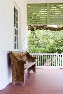 Old Church pew on porch....that would be perfect