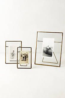 $20-$30 pressed glass photo frames http://www.anthropologie.com/anthro/product/32059412.jsp?color=027&cm_sp=PRODUCT_DETAIL-_-RECOMMENDATIONS-_-32059412#/