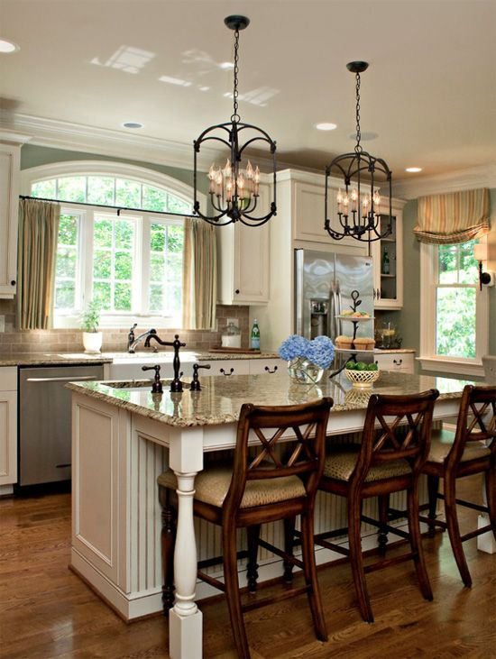 oil rubbed bronze fixtures and hardware with stainless steel appliances, light granite countertops and light cabinets