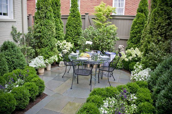 We just love the perfectly coordinated colors in this garden! Designed and…