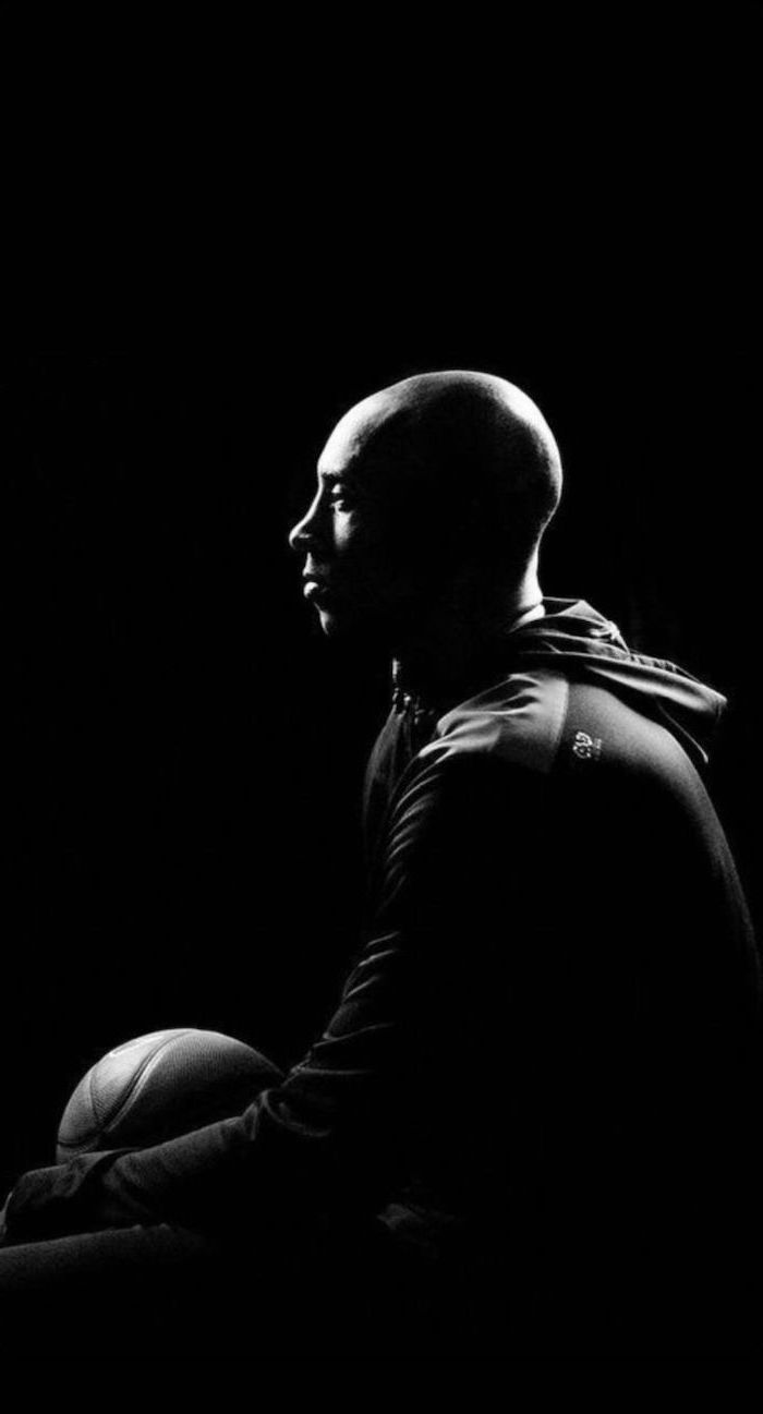 Black And White Photo Of Kobe Sitting Holding A Basketball Photographed From The Side Kobe Wallpaper Kobe Bryant Wallpaper Kobe Bryant Kobe Kobe bryant black and white wallpaper