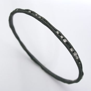 "Todd Pownell: , Bracelet in oxidized sterling silver with 40 channel set diamonds (approx. 1.70 TCW). 2.375"" in diameter."