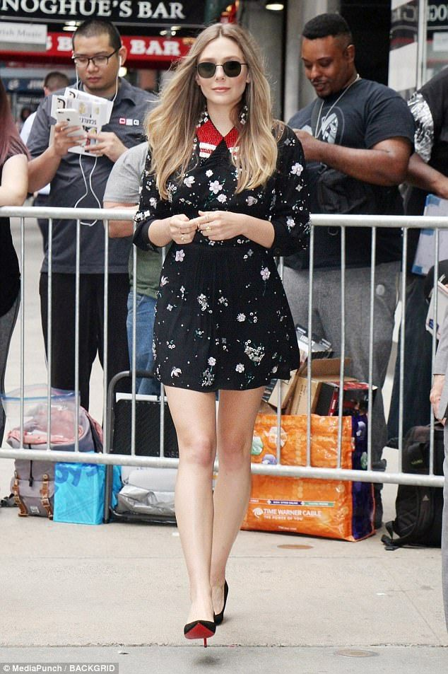 Beaming: Also with the star was his Wind River co-star Elizabeth Olsen who looked lovely in a black floral mini dress