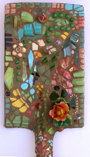 Mosaic shovel for the garden. A way to use broken tile and dishes.