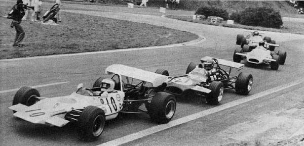 """(10) Tetsu Ikuzawa - Lotus 69 Cosworth FVA - Tetsu Ikuzawa Racing Partnership and (27) Henri Pescarolo - Brabham BT30 - FVA - Bob Gerard Racing exit """"Nouveau Monde"""" - XVIII Grand Prix de Rouen 1970"""