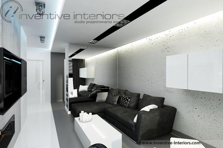 Projekt salonu Inventive Interiors - szara ściana imitująca beton w męskim salonie