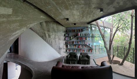 Concrete walls twist up through the interior of this tea house and library that Shanghai architects Archi-Union have constructed in the backyard of their studio.  Love the twisted bookshelves.