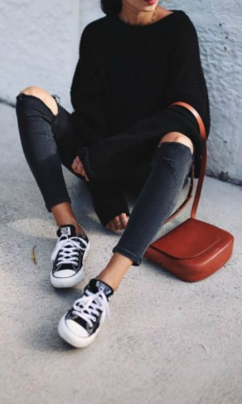Andy Csinger + black and white low-top converse + rolled distressed jeans + cosy black knitted sweater   Sweater: H&M, Jeans: Topshop, Shoes: Converse.