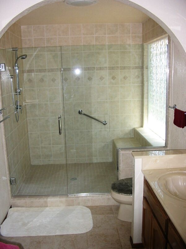Frameless shower door and built in seat