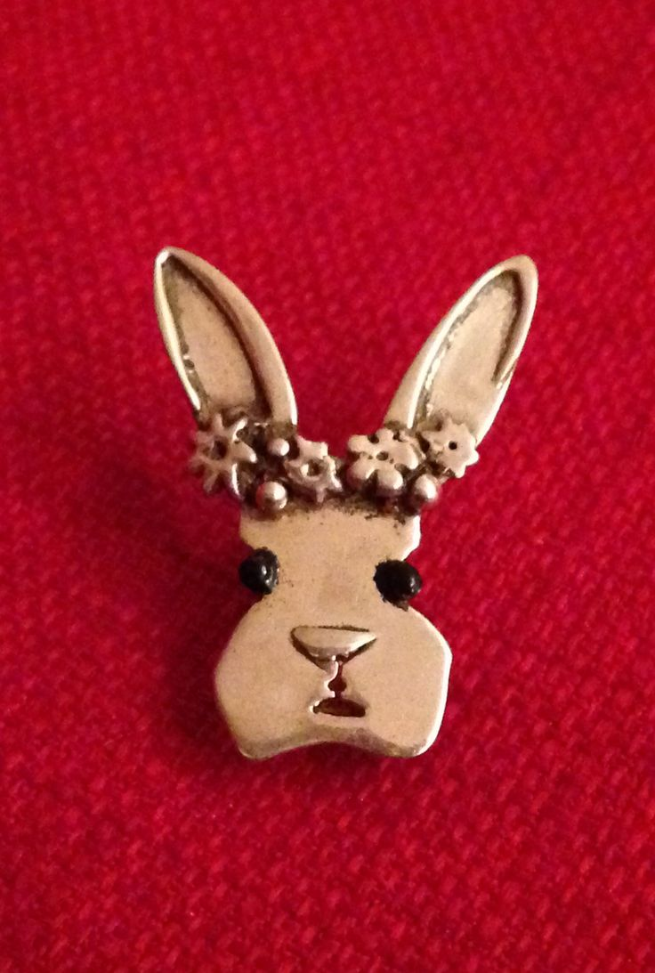 Silver bunnie brooch hand made by Helen Green using silver sheet, silver clay and enamel.