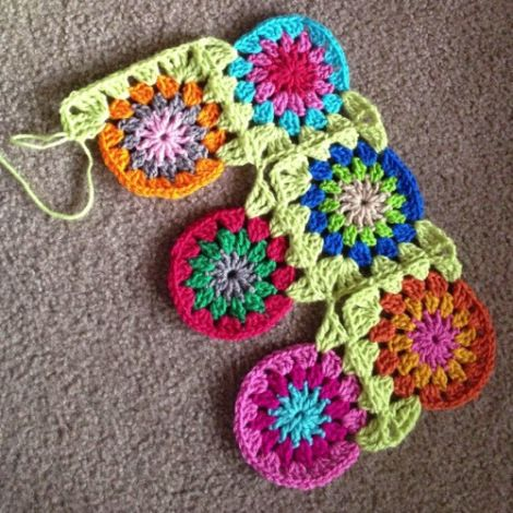 20130827-194535.jpg continuous join-as-you-go granny squares can be made into blanket. I also think this would work for the granny square baby jacket I like to make.