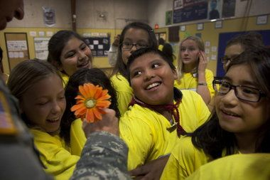 Butternut Creek Elementary students cheer veterans and hear an incredible story thanks to History Channel's Take a Veteran to School Day & Frontier Communications.
