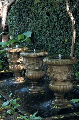 If there's one place where repetition work's it's in a water feature. While one of these classic urns would look attractive in this romantic garden at Morells Boutique Avenue, three makes a real statement. For a more contemporary setting, try rectangular stainless steel or smooth ceramic pots. Always make sure that the overall size of the feature is in proportion to the surroundings. Photograph: Christoph Hoffman
