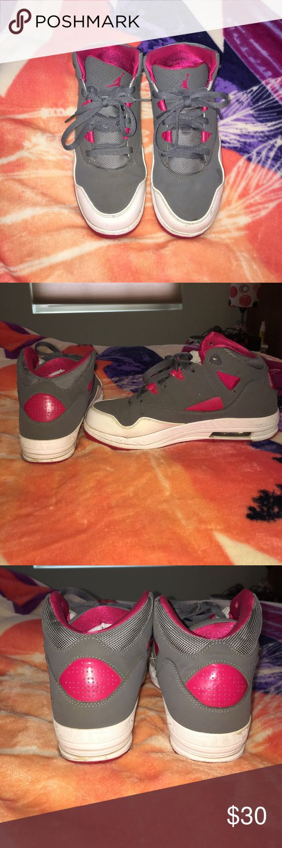 Jordan's sneakers Only worn a few times, good condition. Grey and pink Jordan sneakers. Size 7 in kids Jordan Shoes Sneakers
