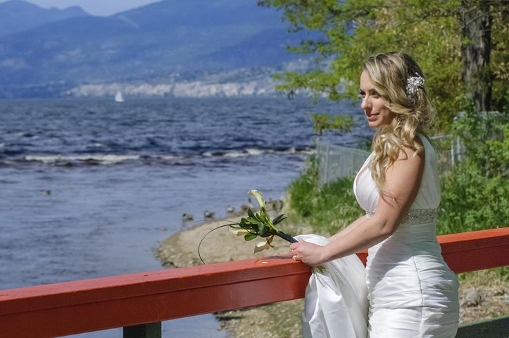 Bride stands looking at Okanagan Lake. This is the bridge to the Penticton Ornamental Gardens. The Wedding Reception was held on the SS Sicamous Stern Wheeler, Penticton (right on the lake side).