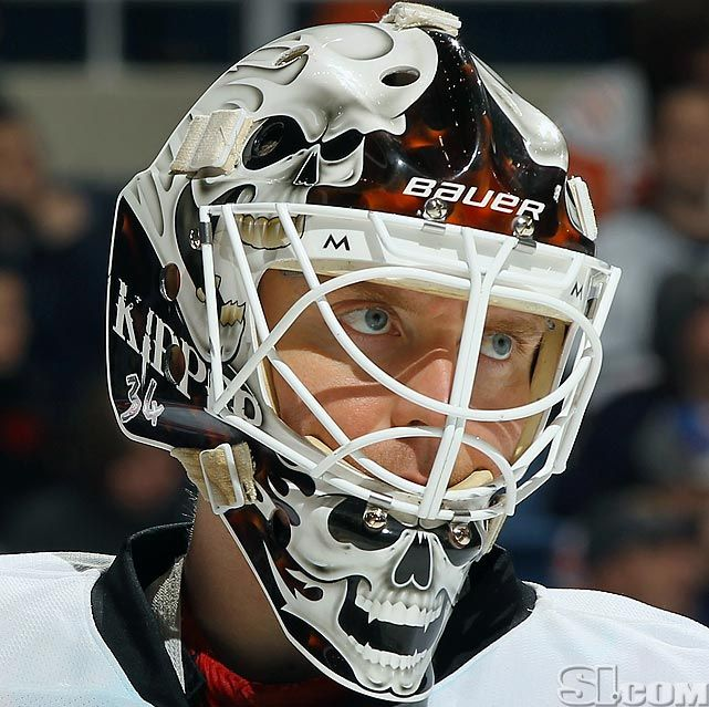 NHL Goalie Masks By Team | ... Calgary Flames - NHL Goalie Masks by Team (2011-12) - Photos - SI.com