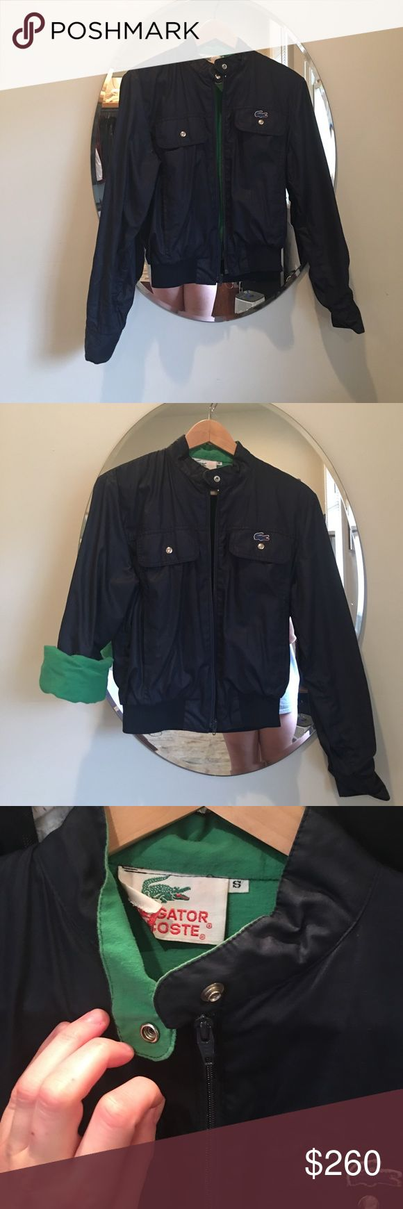 Small Vintage Navy & Green Lacoste Bomber Jacket Vintage Navy Lacoste Bomber Jacket, size Small, with a green cotton lining and cuffs that unbutton & roll up! Has 2 Front Pockets, as well as 2 hand pockets, and zips with a button on the collar. In gorgeous condition. NOT REALLY FOR SALE, Just part of my closet. Lacoste Jackets & Coats Utility Jackets