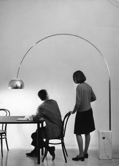 The Arco floor lamp was designed by the Castiglioni brothers in 1962 for the Flos Lighting Company.  - the Flos Company still manufacturers the Arco lamp as well as many of the other Castiglionis' lamps.