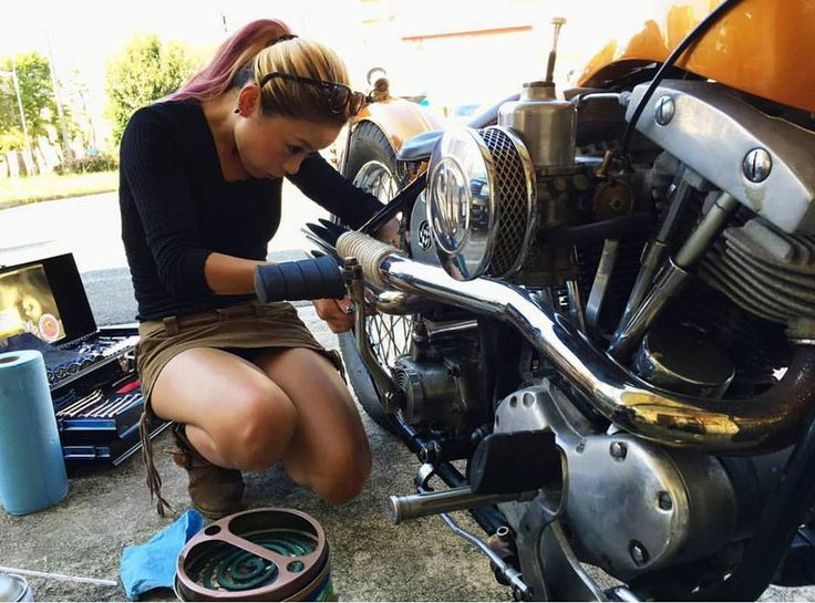 Wrenching on a shovelhead chop. I wonder if she has any clue what she's doing, or if she's just there for a photo shoot ????