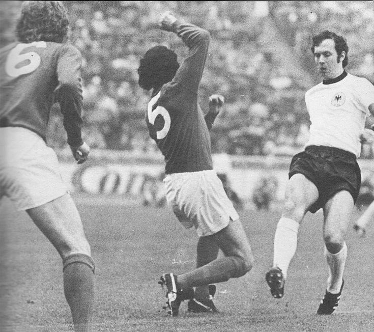 13th May 1972. England duo Bobby Moore and Roy McFarland attempting to stop West German captain Franz Beckenbauer in the Nations Cup Quarter Final 2nd Leg, in Berlin.