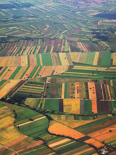 Agricultural Patchwork A view of the Austrian countryside from Austrian Arrows Bombardier Dash 8 Q400 OE-LGG while on approach to Vienna Schwechat Airport.