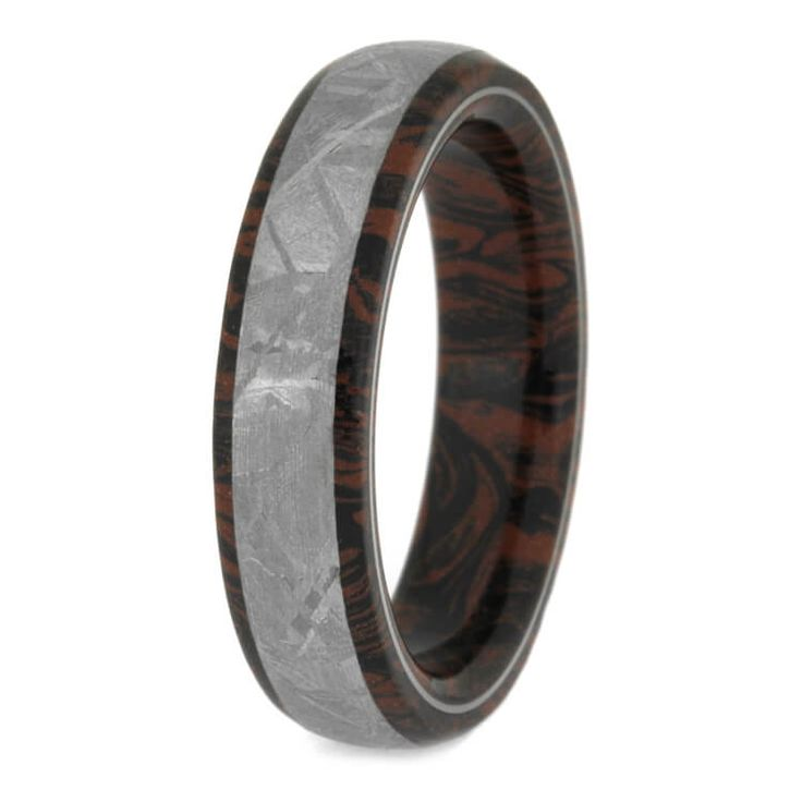 Customize your gibeon meteorite wedding band to be as unique as your personality. This mokume gane ring is overlaid with a stripe of gibeon meteorite.