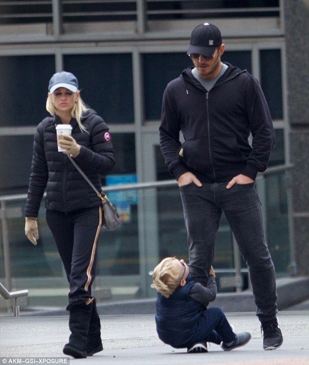 All aboard! Chris Pratt's son Jack clung to his leg during a family outing along with wife Anna Faris on Tuesday
