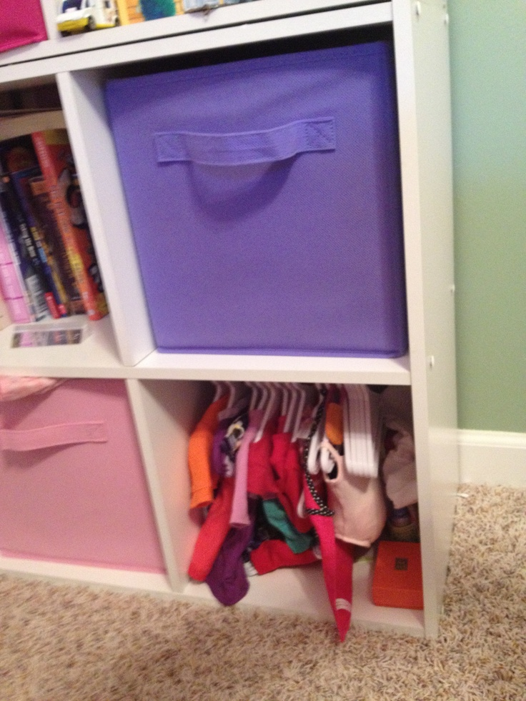 """""""Closet"""" for doll clothes in a storage cubicle."""