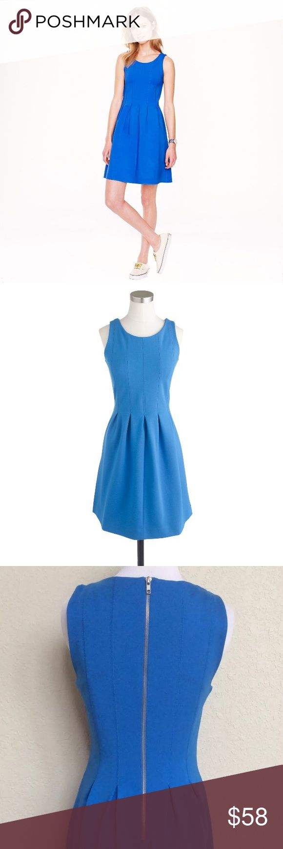 J. Crew Pleated Flare Dress in Electric Blue Tailored from a stretchy-but-structured electric blue fabric, this dress couldn't be easier or more comfortable to wear! A perfect blend of rayon, nylon, and a little spandex, this dress falls above the knee and is completed with a back gold zipper closure and bra keeps. Getting ready in the morning just got so much easier! J. Crew Dresses