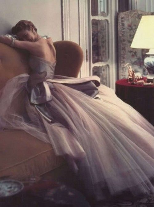 Jean Patchett in a tulle evening gown photographedy by Norman Parkinson forVogue,1950.