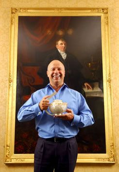 Former Deacon of The Incorporation of Goldsmiths, Michael Laing, with the diamond studded teapot