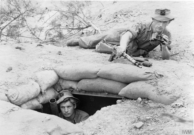 British; King's Own Scottish Borderers, 1st Battalion. Two inch mortar team. In the pit is Private Tom Lapere, with Private Alec Ewan directing the fire.
