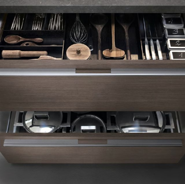 POLIFORM|VARENNA_The ample variety of uses of the pull-out baskets is reflected in the completeness of the collection Varenna. In the picture above, the upper compartment is quipped with cutlery canteen, knife-rack in wenge and spices-rack in metal. The lower compartment is used for pots but can be equipped with plate rack of variable diameter in steel and wood or steel and corian.