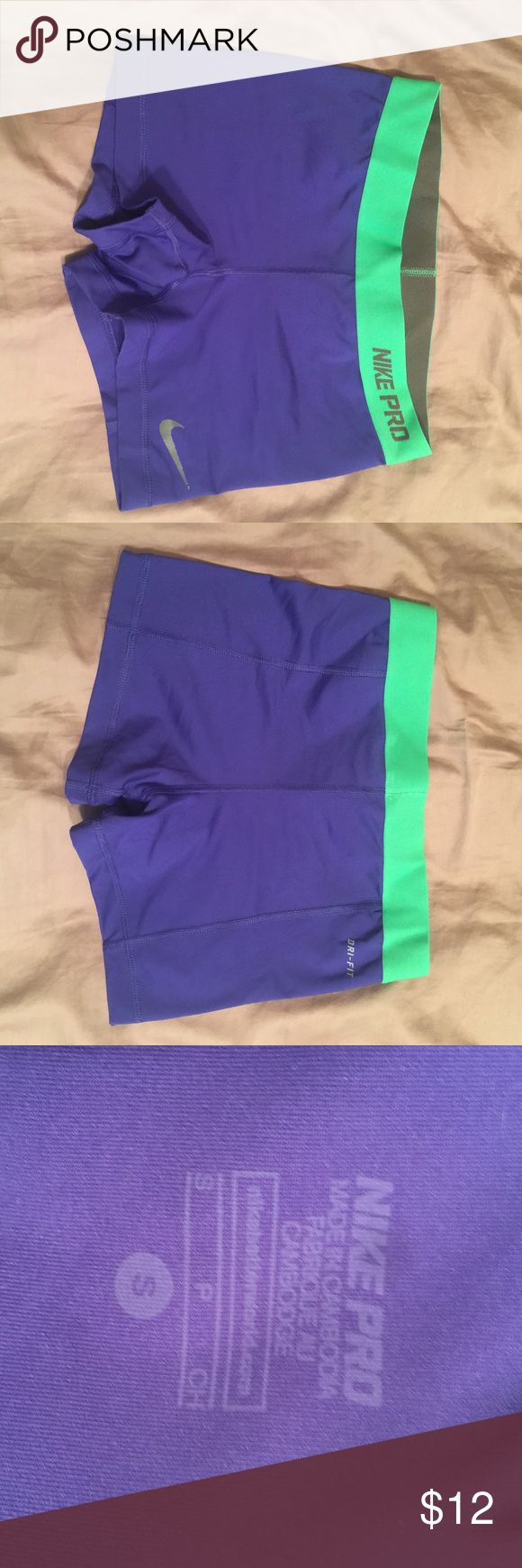 Nike Compression Shorts small Nike bright purple/blue with bright green band. No stains, tears or imperfections. Size small Nike Shorts