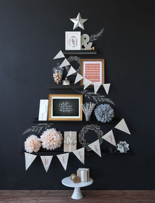 Strategically hang your shelves from shortest to longest and decorate them with festive fillers.