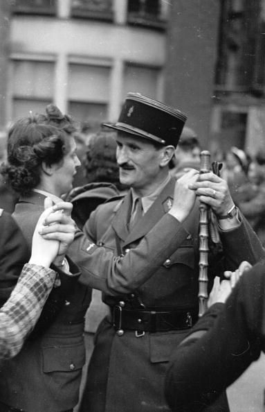 14th July 1943: Despite the war, French people in London celebrate France's Bastille Day by dancing in the streets. They are commemorating the storming of the Bastille prison in Paris on July 14th 1789, during the French Revolution. Original Publication: Picture Post - 1493 - Street Dancing For France's July 14th - pub. 1943 ~