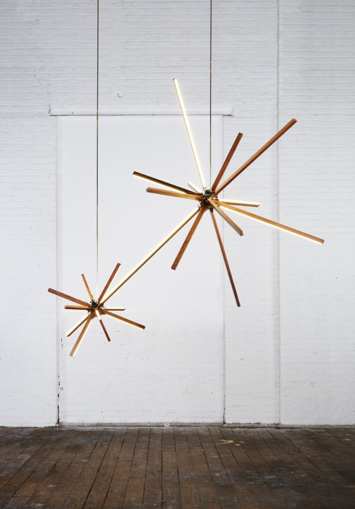 "Stickbulb's Boom pendant, expresses its forms through using minimal elements: cast-brass joints and linear wooden LED bulbs that create forms of exploding light. At the centre of the fixture is a singularity of cast-brass joints, elegantly curved to dramatically reflect the geometry of the fixture. The result illustrating what they call ""the destruction of architecture"". See more booming lights at LightForm.ca"