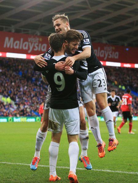 Luke Shaw and Adam Lallana congratulate Jay Rodriguez upon scoring: Cardiff City v Southampton on December 26th. 2013.