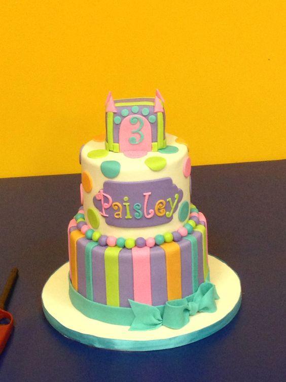 Pretty pastel bounce house birthday cake