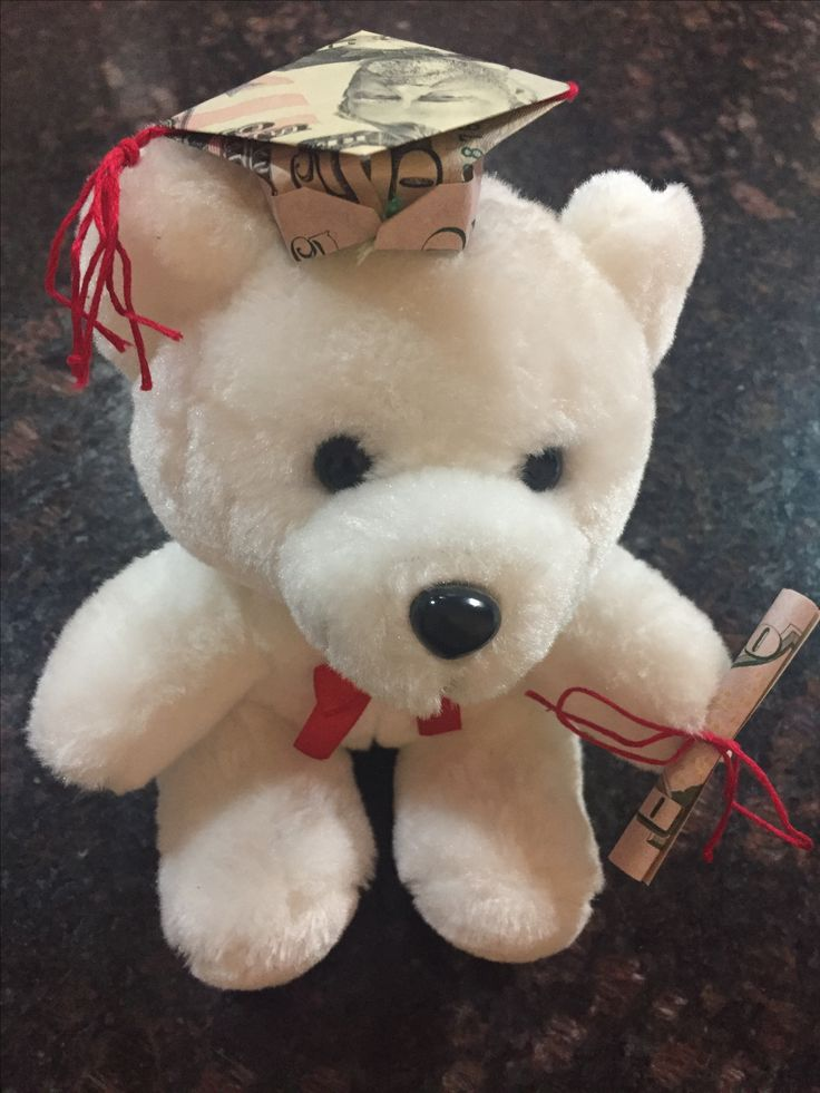 Graduation teddy bear that I made for my cousin. Made the cap and diploma out of 50 dollar bills and just pinned them to the bear.