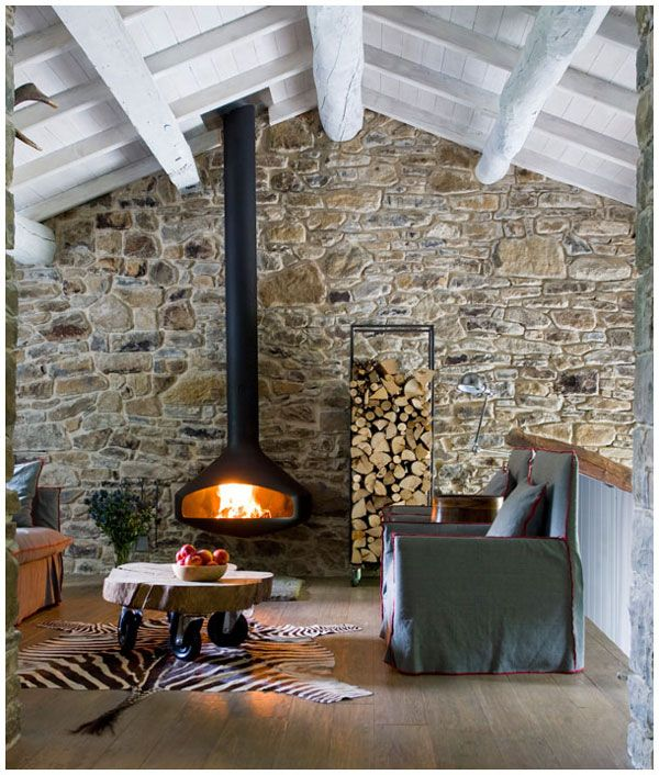 love the suspended stove, stone wall, white wash beams, but honestly that zebra rug's tail weirds me out