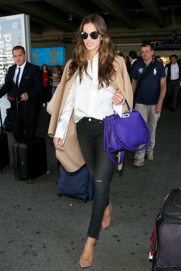 Supermodel Izabel Goulart spotted at Nice Airport with a bright Fendi Peekaboo bag with lace-up details and Fendi Eyeshine sunglasses.