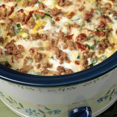 Ingredients 1 pkg. (26-32 oz) frozen shredded hash brown potatoes 1 pkg. Jimmy Dean® Hearty Original Sausage Crumbles 2 cup (8 oz) shredded mozzarella cheese ½ cup (2 oz) shredded Parmesan cheese ½ cup julienne cut sun dried tomatoes packed in oil, drained 6 	green onions, sliced 12 eggs ½ cups milk ½ tsp salt ¼ tsp ground black pepper
