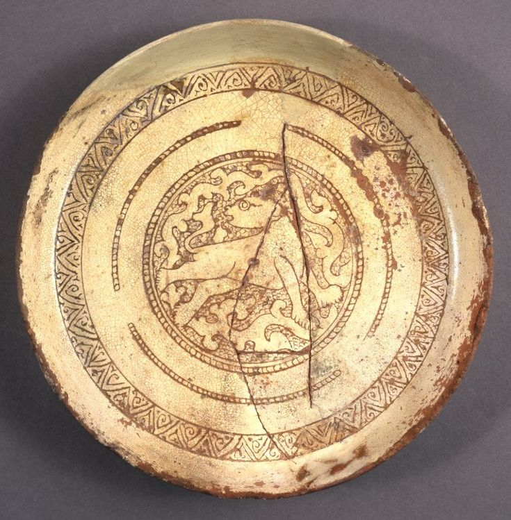 Dish; red earthenware; yellow glaze; flat with turned up rim; decorated in sgraffito with a lion enclosed by various geometric borders. Culture/periodMiddle Byzantine term details Date12thC FindspotFound/Acquired: Aegean Sea(Mediterranean,Mediterranean Sea,Aegean Sea)