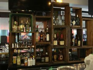 Awesome wooden crate bar setup.